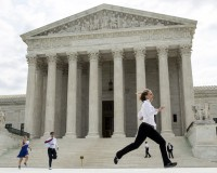 Interns with media organizations run with the decision upholding the Affordable Care Act at the Supreme Court in Washington June 25, 2015. The U.S. Supreme Court on Thursday upheld the nationwide availability of tax subsidies that are crucial to the implementation of President Barack Obama's signature healthcare law, handing a major victory to the president. REUTERS/Joshua Roberts      TPX IMAGES OF THE DAY      - RTR4YXSO