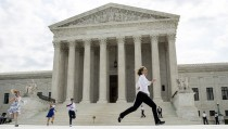 Interns with media organizations run with the decision upholding the Affordable Care Act at the Supreme Court in Washington June 25, 2015. The U.S. Supreme Court has three more decisions to hand down before summer recess, and they are expected Monday. Photo by Joshua Roberts/Reuters