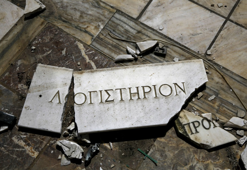 "A broken marble sign that reads ""Accountant's Office"" lies on the floor of a deserted marble factory that closed in 2006 near the town of Larissa in Thessaly region, Greece April 22, 2015. Photo by Yannis Behrakis/Reuters"