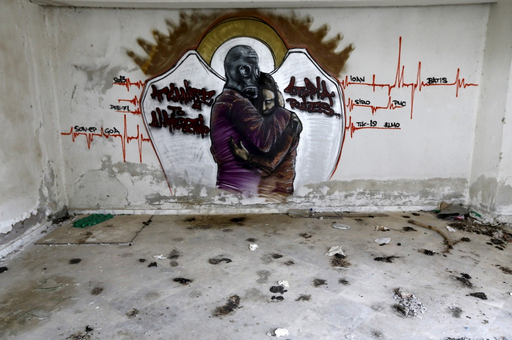 Graffiti is seen inside a deserted fruit packing factory that closed in the late 1990s near the town of Xanthi in Thrace region, Greece April 25, 2015. Photo by Yannis Behrakis/Reuters