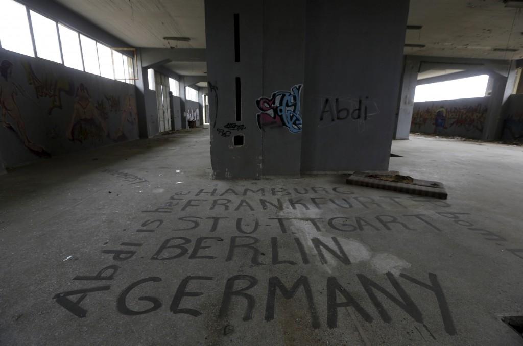 Graffiti is seen inside a deserted dry nut factory that closed in 1995 near the town of Xanthi in Thrace region, Greece April 24, 2015. Photo by Yannis Behrakis/Reuters