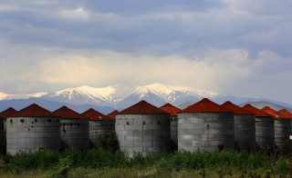Deserted grain silos are seen in front of the snowcapped Mount Olympus near the town of Larissa in Thessaly region, Greece April 22, 2015. Photo by Yannis Behrakis/Reuters