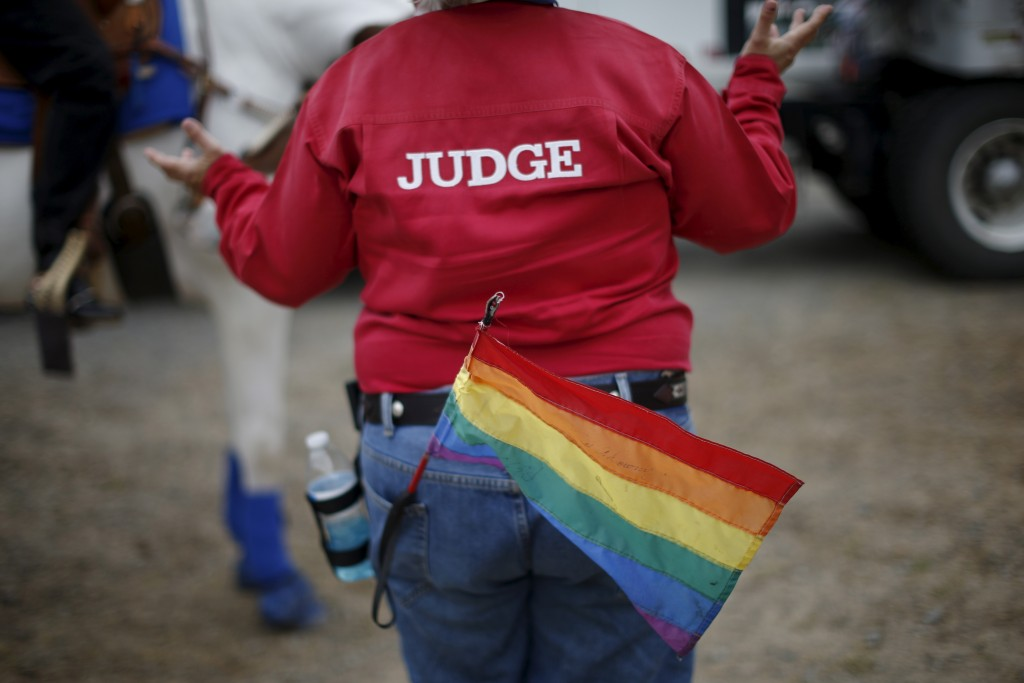 A judge gestures to a competitor at the International Gay Rodeo Association's Rodeo In the Rock in Little Rock, Arkansas, April 26, 2015. Photo by Lucy Nicholson/Reuters
