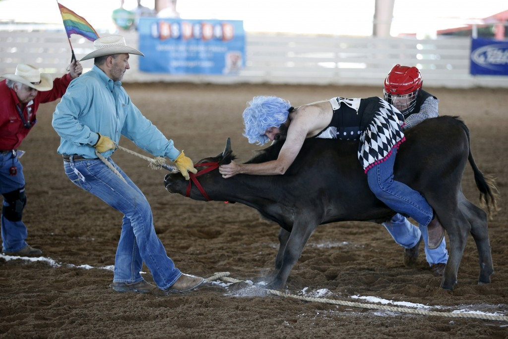 Raymond Norris, 45, rides a steer while competing in the Wild Drag Race at the International Gay Rodeo Association's Rodeo In the Rock in Little Rock, Arkansas, April 25, 2015. Photo by Lucy Nicholson/Reuters