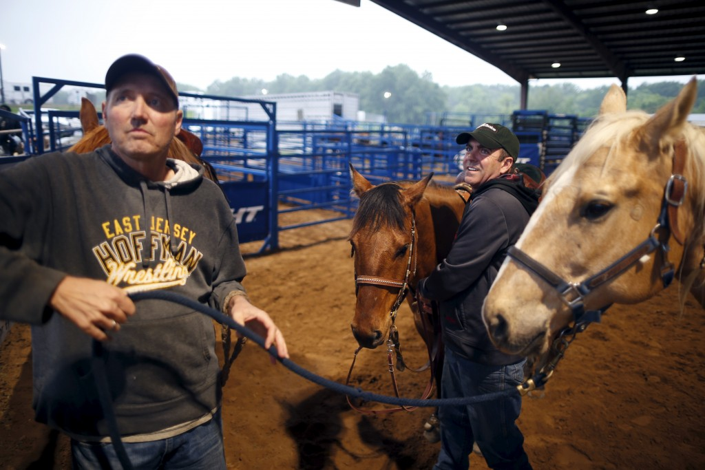Kirk Carter, 51, and his husband Shawn Eddings, 49, warm up with their horses at the International Gay Rodeo Association's Rodeo In the Rock in Little Rock, Arkansas, United States April 24, 2015. Photo by Lucy Nicholson/Reuters