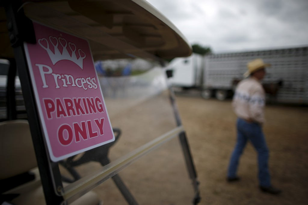 """A golf cart with a """"Princess parking only"""" sign is seen at the International Gay Rodeo Association's Rodeo In the Rock in Little Rock, Arkansas, United States April 26, 2015. Photo by Lucy Nicholson/Reuters"""