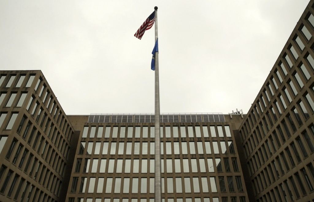 The U.S. national flag is pictured at the Office of Personnel Management building in Washington June 5, 2015. In the latest in a string of intrusions into U.S. agencies' high-tech systems, the Office of Personnel Management (OPM) suffered what appeared to be one of the largest breaches of information ever on government workers. The office handles employee records and security clearances   REUTERS/Gary Cameron  - RTX1FAQF