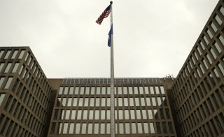 The U.S. national flag is pictured at the Office of Personnel Management building in Washington June 5, 2015. In the latest in a string of intrusions into U.S. agencies' high-tech systems, the Office of Personnel Management (OPM) suffered what appeared to be one of the largest breaches of information ever on government workers. The office handles employee records and security clearances   REUTERS/Gary Cameron- RTX1FAQF