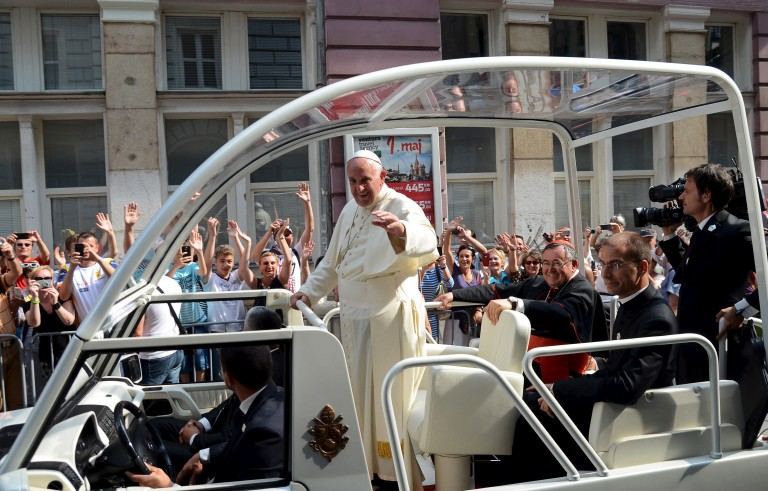 "Pope Francis waves from his ""popemobile"" along a street in Sarajevo, Bosnia and Herzegovina on June 6. Photo by Reuters stringer"