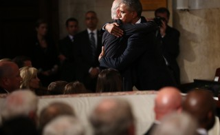 U.S. President Barack Obama (R) hugs Vice President Joe Biden during the funeral of former Delaware Attorney General Beau Biden, son of Vice President Joe Biden, at St. Anthony of Padua Church in Wilmington, Delaware June 6, 2015. REUTERS/Doug Mills/Pool - RTX1FE8D