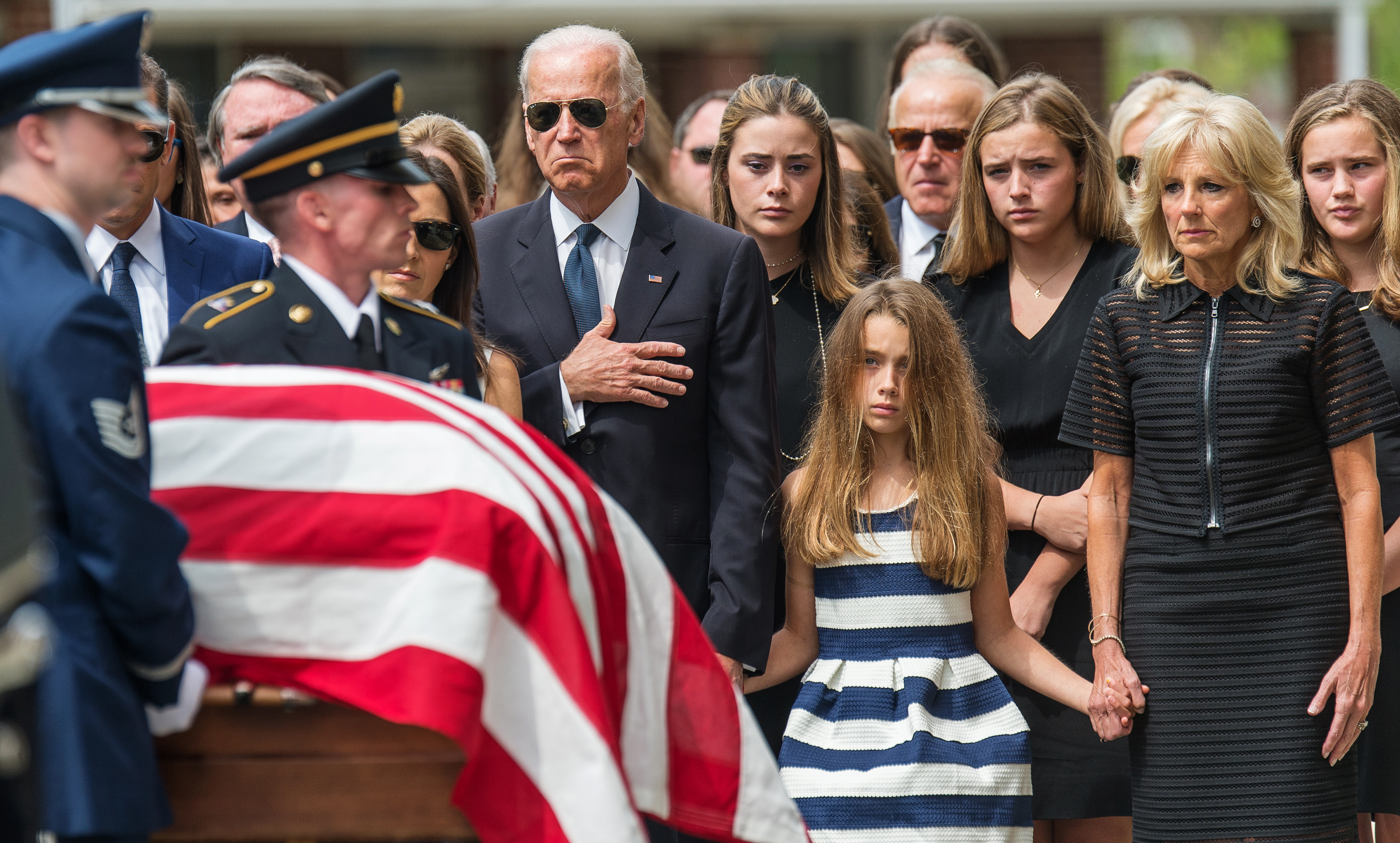 Vice President Joe Biden (R), puts his hand on his heart as he and granddaughter Natalie and stepmother Jill Biden look on before a funeral mass for former Delaware Attorney General Beau Biden, son of Vice President Biden, at St. Anthony of Padua Church in Wilmington, Delaware June 6, 2015. Photo by Bryan Woolston/Reuters