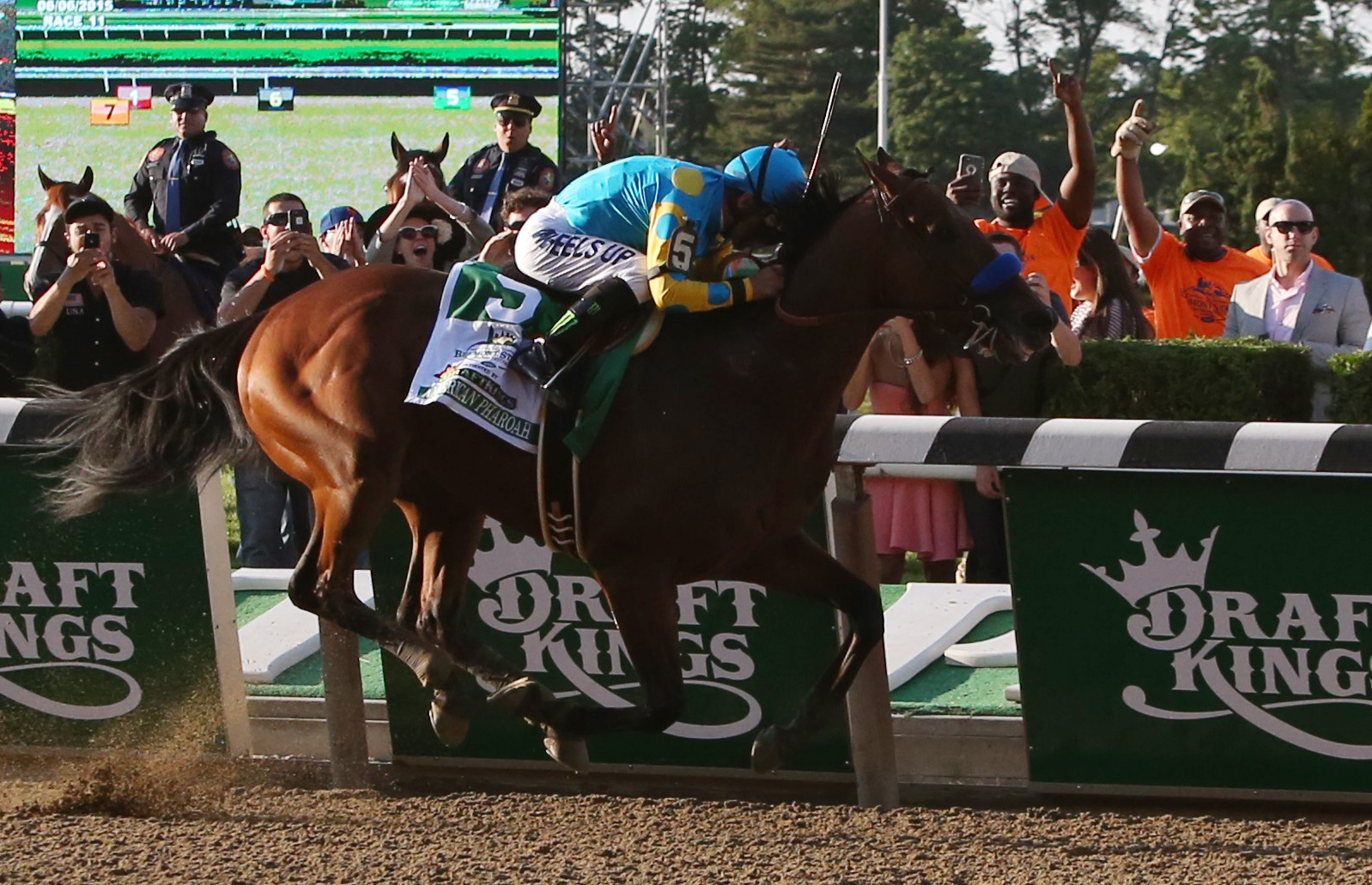 Espinoza and American Pharoah near the finish line. Photo by Carlo Allegri/Reuters