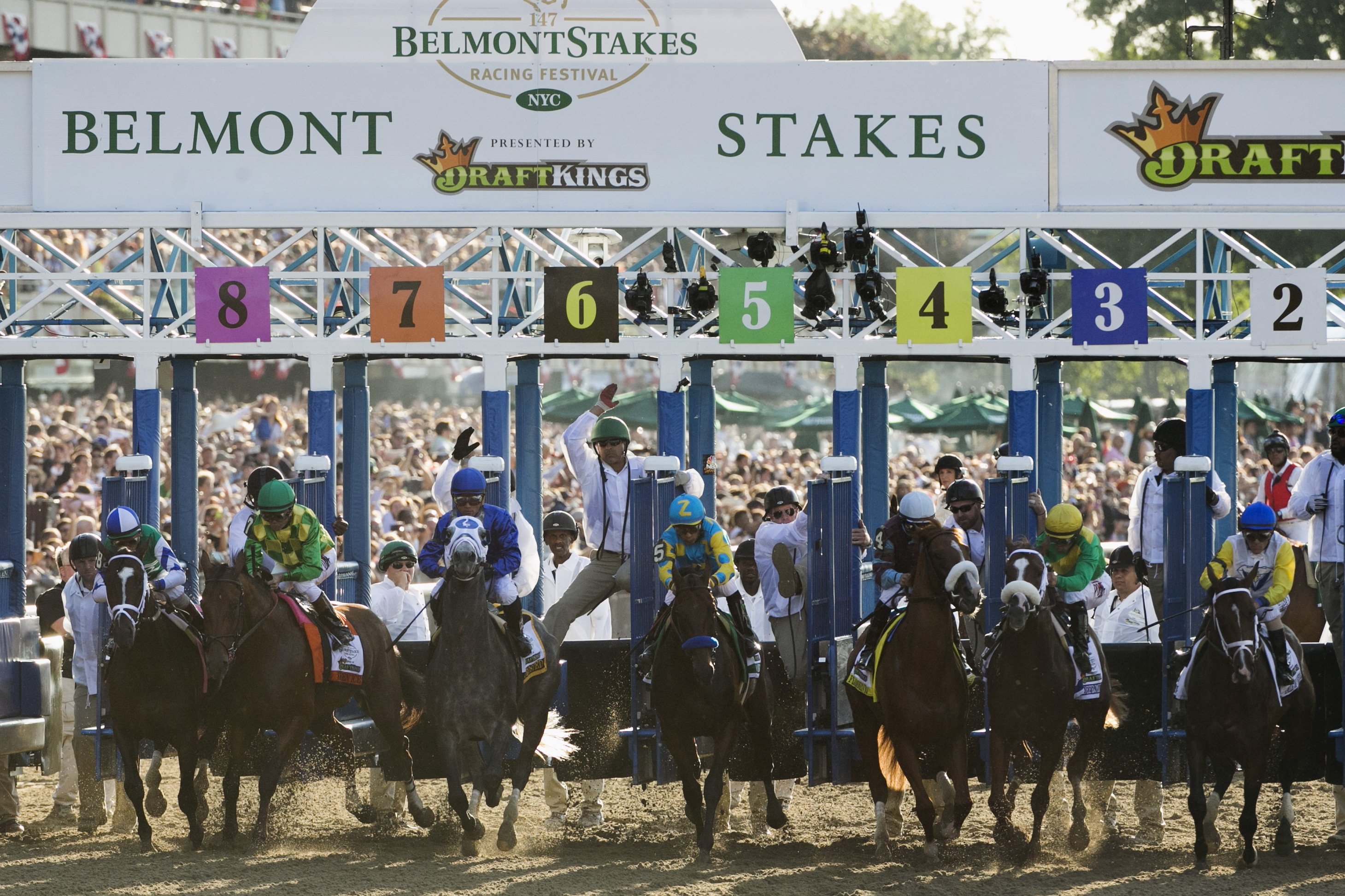 Jockey Victor Espinoza, aboard American Pharoah (C), takes off for the start of the 147th running of the Belmont Stakes as well as the Triple Crown, in Elmont, New York on June 6, 2015. Photo by Lucas Jackson/Reuters
