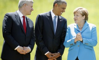 Canada's Prime Minister Stephen Harper, U.S. President Barack Obama and German Chancellor Angela Merkel (L-R) prepare for a family photo during their meeting at the hotel castle Elmau in Kruen, Germany, June 7, 2015. Obama and Merkel begin the G7 summit with statements of great appreciation for their ongoing friendship. Photo by Christian Hartmann/Reuters