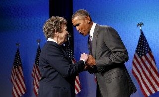 Catholic Health Association President and CEO Sister Carol Keehan (L) greets U.S. President Barack Obama as he takes the stage for remarks at the Catholic Health Association conference in Washington June 9, 2015. Jonathan Ernst/Reuters
