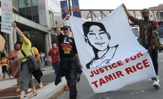 Jun 9, 2015; Cleveland, OH, USA; Tadar Muhammad (right) and Jeremy Brustein (left) demonstrate in support of Tamir Rice outside of Quicken Loans Arena prior to game three of the NBA Finals. Mandatory Credit: Ken Blaze-USA TODAY Sports - RTX1FV2B