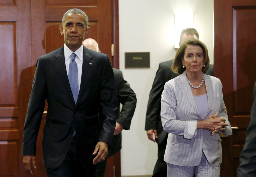 President Obama and House Democratic leader Nancy Pelosi walk from a meeting room after making a last-ditch appeal to House Democrats to support a package of trade bills vital to his Asian policy agenda in the U.S. Capitol in Washington June 12,  2015. Photo by Kevin Lamarque/Reuters