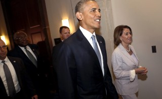 U.S. President Barack Obama departs with House Minority Leader Nancy Pelosi (D-CA) (R) after meeting with Democratic House members to push for trade legislation at the U.S. Capitol in Washington June 12, 2015.  REUTERS/Jonathan Ernst - RTX1G98C