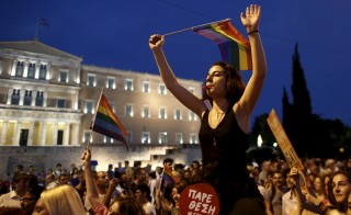 Gay rights activists march in front of the parliament building during a Gay Pride parade in Athens, June 13, 2015.  Photo by Kostas Tsironis/Reuters