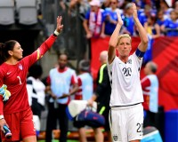 Jun 16, 2015; Vancouver, British Columbia, CAN; United States forward Abby Wambach (20) and goalkeeper Hope Solo (1) acknowledge the crowd after their win over Nigeria in a Group D soccer match in the 2015 FIFA women's World Cup at BC Place Stadium. The United States won 1-0 and win Group B. Mandatory Credit: Anne-Marie Sorvin-USA TODAY Sports - RTX1GTHG