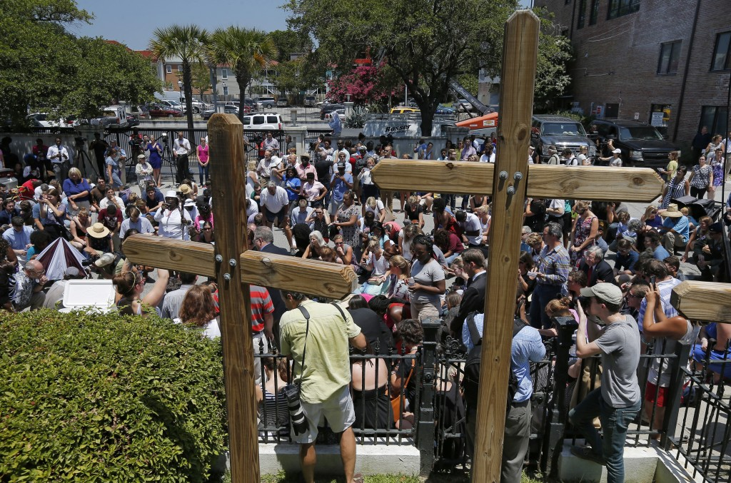 Mourners gather outside Morris Brown AME Church for a vigil on June 18, the day after a mass shooting in Charleston, South Carolina. Photo by Brian Snyder/Reuters