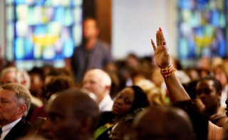 People attend a prayer vigil Thursday at Morris Brown AME Church in Charleston, South Carolina, less than a mile from Emanuel African Methodist Episcopal Church where a gunman killed nine people the night before. Grace Beahm/Pool/Reuters