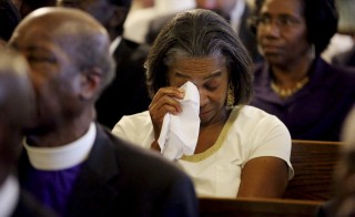 Marie Goff wipes tears from her eyes during a prayer vigil at Morris Brown AME Church in Charleston, South Carolina, Thursday. Photo by Grace Beahm/Pool/Reuters