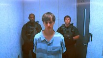 Dylann Storm Roof appears by closed-circuit television at his bond hearing in Charleston, South Carolina June 19, 2015 in a still image from video. A 21-year-old white man has been charged with nine counts of murder in connection with an attack on a historic black South Carolina church, police said on Friday, and media reports said he had hoped to incite a race war in the United States. REUTERS/POOL - RTX1HBQ7