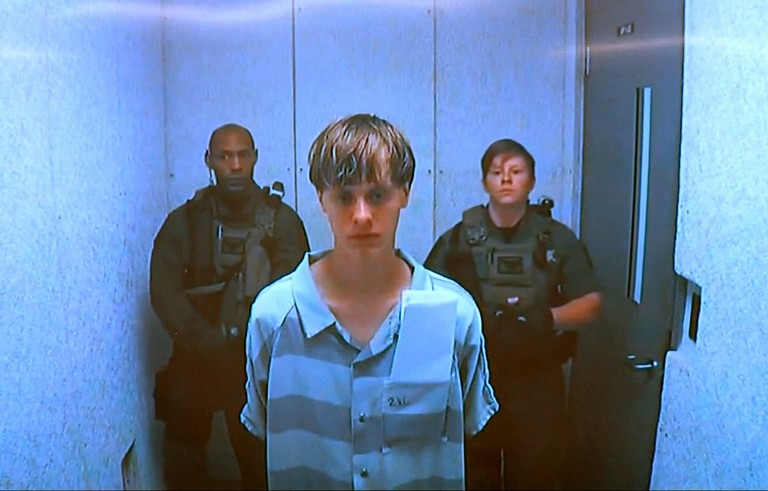 Dylann Storm Roof appears by closed-circuit television at his bond hearing in Charleston, South Carolina June 19, 2015 in a still image from video. A 21-year-old white man has been formally indicted on nine counts of murder and three counts of attempted murder in connection with an attack on a historic black South Carolina church. Photo provided by Reuters