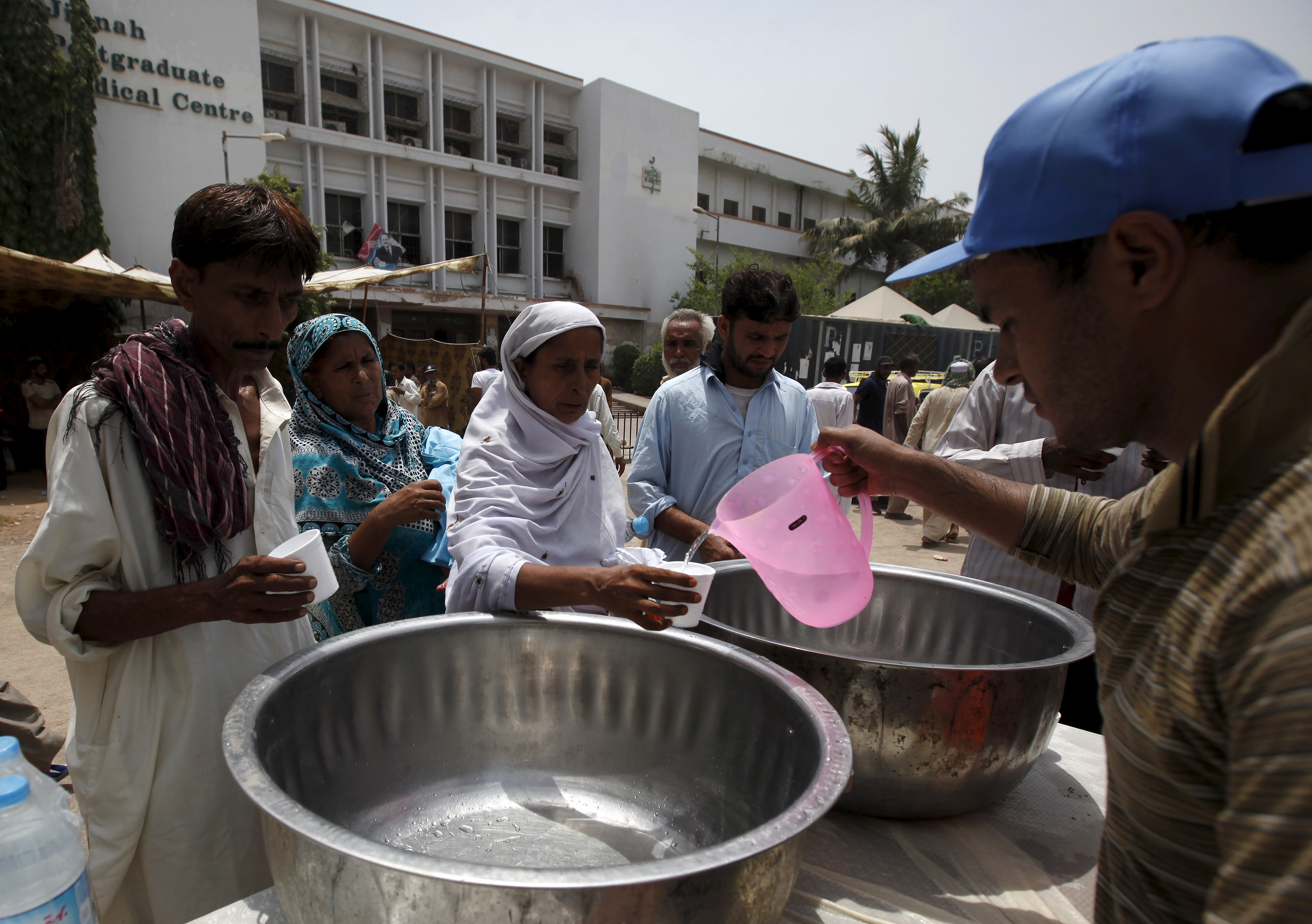 Volunteers hand out drinking water outside the Jinnah Postgraduate Medical Center in Karachi, Pakistan on June 23. Photo by Akhtar Soomro/Reuters