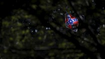 The Confederate flag flies at the State House ahead of a rally to get it removed from the grounds in Columbia, South Carolina June 23, 2015. South Carolina lawmakers plan to introduce a resolution on Tuesday to begin a debate on removing the Confederate flag from the State House grounds following the killings of nine African-American churchgoers allegedly by a white gunman. REUTERS/Brian Snyder - RTX1HRWL