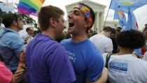 Gay rights supporters celebrate after the U.S. Supreme Court ruled that the U.S. Constitution provides same-sex couples the right to marry, outside the Supreme Court building in Washington Friday. Photo by Jim Bourg/Reuters