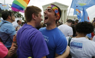 Gay rights supporters celebrate after the U.S. Supreme Court ruled that the U.S. Constitution provides same-sex couples the right to marry, outside the Supreme Court building in Washington, June 26, 2015. In what's being called a historical, landmark decision, gay marriage will now be legal in all 50 states. Photo by Jim Bourg/Reuters