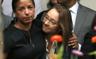 U.S. National Security Advisor Susan Rice, left, embraces an unidentified White House staff member after President Barack Obama's comments on the Supreme Court ruling on the constitutionality of same-sex marriage. Photo by Gary Cameron/Reuters