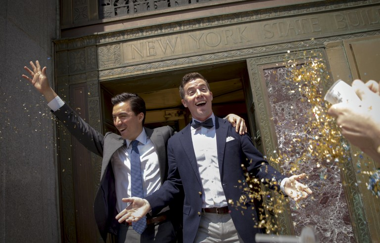Rodrigo Zamora (L) and Ashby Hardesty exit the New York City clerks office after their wedding in Manhattan in New York June 26, 2015. Photo by Brendan McDermid/Reuters