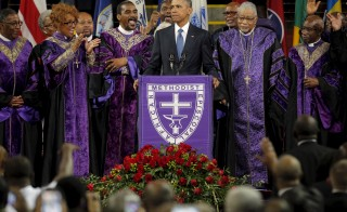 "President Barack Obama leads mourners in singing the hymn ""Amazing Grace"" as he delivers a eulogy in honor of the Reverend Clementa Pinckney during funeral services for Pinckney in Charleston, South Carolina June 26, 2015. Photo by Brian Snyder/Reuters"