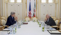 """U.S. Secretary of State John Kerry (L)  meets with Iranian Foreign Minister Javad Zarif at a hotel in Vienna, Austria June 30, 2015.  Kerry and  Zarif held a """"productive"""" meeting in Vienna on Tuesday, the State Department said, as negotiations on curbing Iran's nuclear program were extended. REUTERS/State Department/Handout  FOR EDITORIAL USE ONLY. NOT FOR SALE FOR MARKETING OR ADVERTISING CAMPAIGNS. THIS IMAGE HAS BEEN SUPPLIED BY A THIRD PARTY. IT IS DISTRIBUTED, EXACTLY AS RECEIVED BY REUTERS, AS A SERVICE TO CLIENTS - RTX1IHEE"""
