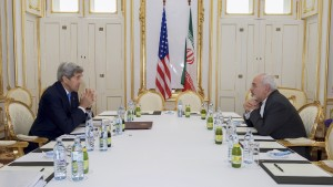 "U.S. Secretary of State John Kerry (L)  meets with Iranian Foreign Minister Javad Zarif at a hotel in Vienna, Austria June 30, 2015.  Kerry and  Zarif held a ""productive"" meeting in Vienna on Tuesday, the State Department said, as negotiations on curbing Iran's nuclear program were extended. REUTERS/State Department/Handout  FOR EDITORIAL USE ONLY. NOT FOR SALE FOR MARKETING OR ADVERTISING CAMPAIGNS. THIS IMAGE HAS BEEN SUPPLIED BY A THIRD PARTY. IT IS DISTRIBUTED, EXACTLY AS RECEIVED BY REUTERS, AS A SERVICE TO CLIENTS - RTX1IHEE"