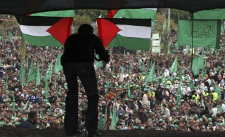 A Palestinian takes pictures of a Hamas rally in Gaza City on December 14, 2009. An Egyptian appeals court on Saturday reversed a lower court decision designating Hamas as a terrorist group. Photo by Suhaib Salem/Reuters