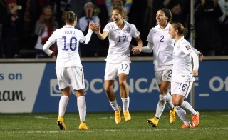 Oct 17, 2014; Bridgeview, IL, USA; USA player Carli Lloyd (10) celebrates with teammates Tobin Heath (17) , Sydney Leroux (2) and Meghan Klingenberg (16) after scoring a goal against Guatemala during a women's World Cup qualifier soccer match at Toyota Park. Mandatory Credit: Jerry Lai-USA TODAY Sports - RTR4AMR6