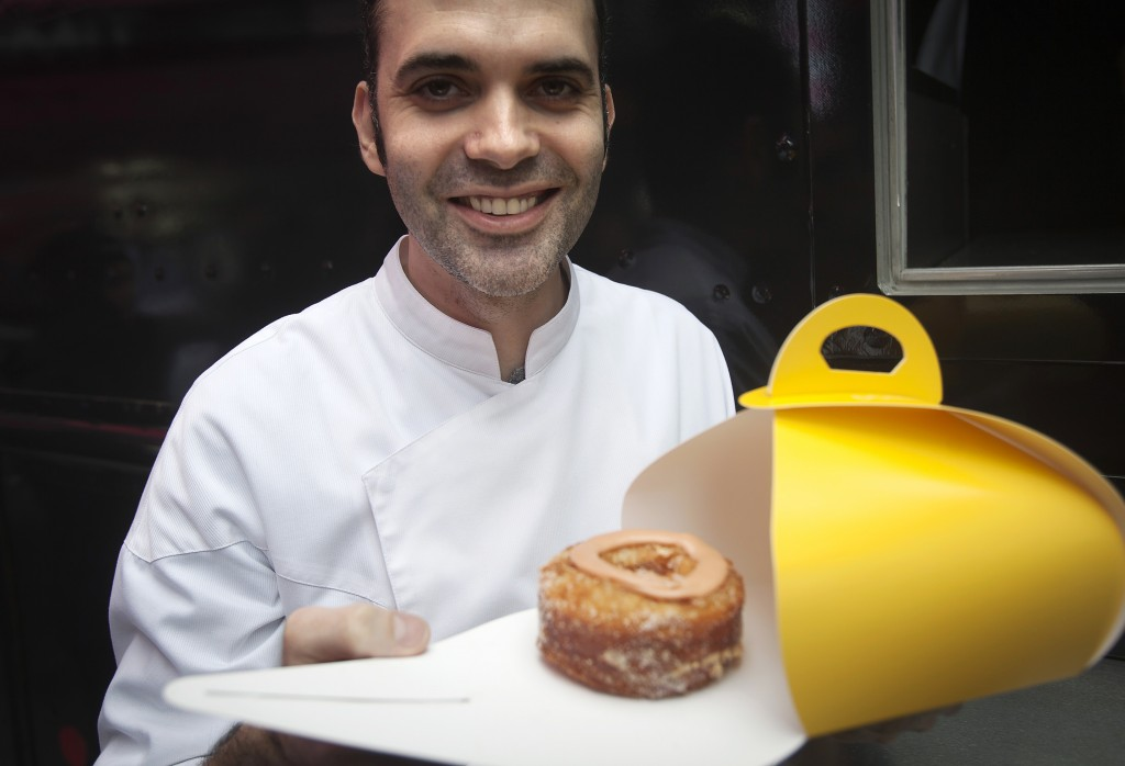 Celebrity baker Dominique Ansel, creator of the cronut, poses for a photo during a publicity event in Times Square in New York Dec. 28, 2014. Photo by Carlo Allegri/Reuters