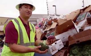 Operations manager Cesar Zuniga holds fresh produce bound for the landfill in Salinas, California. Photo by Jason Lelchuk