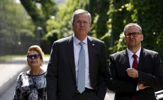 Former Florida Governor and potential Republican presidential candidate Jeb Bush and his wife Columba (L) walk with Museum director Jan Oldakowski (R) in front of the Memory Wall at the  Warsaw Uprising Museum in Warsaw, Poland, on June 11, 2015. Bush, expected to announce his candidacy for the 2016 Republican presidential fight on June 15. The trip to Germany, Poland and Estonia is designed to raise his foreign policy credentials before he launches his candidacy for the Republican presidential nomination. Photo by Kacper Pempel/Reuters