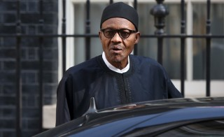 Nigeria's President-elect Muhammadu Buhari departs after meeting with Britain's Prime Minister David Cameron at Downing Street in London, England, May 23, 2015. REUTERS/Neil Hall - RTX1E7E7