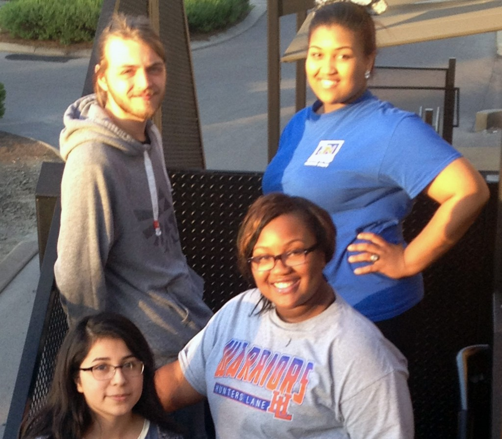 Recent Hunters Lane High School graduates Paul Kline, Dianna Thomas, Courtaijaha Brooks-James and Virginia Cruz will assume dramatically different debt burdens when they go to college in the fall. (Photo: Lee Gray/The Hechinger Report)