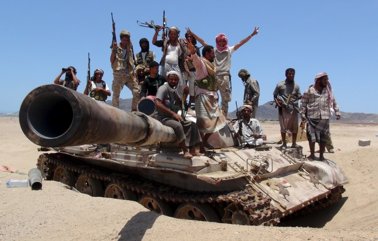 Anti-Houthi fighters of the Southern Popular Resistance stand on a tank in Yemen's southern port city of Aden on May 10, 2015. Photo by Reuters