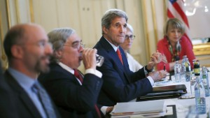 U.S. Secretary of State John Kerry (C) meets with Iranian Foreign Minister Mohammad Javad Zarif (not pictured) at a hotel in Vienna, Austria, July 3, 2015. A year and half of nuclear talks between Iran and major powers are meant to culminate in a deal expected Tuesday, though Kerry said Saturday that a successful deal is not necessarily a sure thing.  Photo by Carlos Barria/Reuters