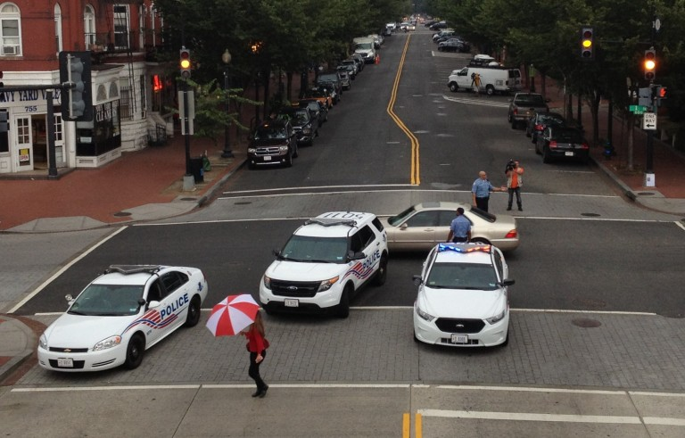 Police block the intersection of I and 8th Street near the Navy Yard in southeastern Washington, D.C., on Sept. 16, 2013. The U.S.  Navy base was closed after several people were shot on the  base. Photo by Melina Mara/The Washington Post via Getty Images
