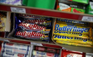 SAN FRANCISCO, CA - FEBRUARY 18:  Nestle Butterfinger and Baby Ruth candy bars are displayed on a shelf at a convenience store on February 18, 2015 in San Francisco, California.  Nestle USA announced plans to remove all artificial flavors and FDA-certified colors from its entire line of chocolate candy products, including the popular Butterfinger and Baby Ruth candy bars, by the end of 2015.  (Photo by Justin Sullivan/Getty Images)