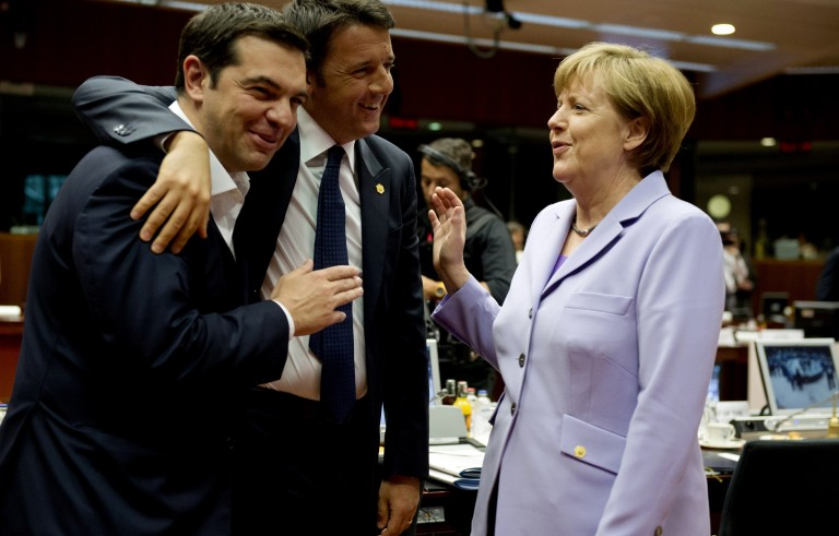 Greek prime minister Alexis Tsipras(L), his Italian counterpart Matteo Renzi (C) and German Chancellor Angela Merkel share a light moment before the start of a round table meeting as part on an EU summit at the EU headquarters in Brussels on June 25, 2015.    Talks between eurozone finance ministers broke up without agreeing on a Greek debt deal, with a new meeting due in coming days, Finland's Alexander Stubb said. AFP PHOTO/ ALAIN JOCARD        (Photo credit should read ALAIN JOCARD/AFP/Getty Images)